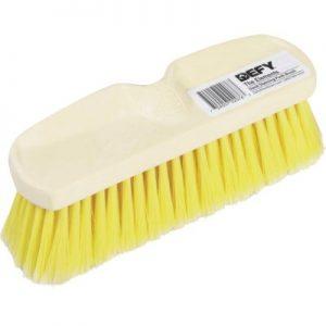 beige wash brush with yellow bristles