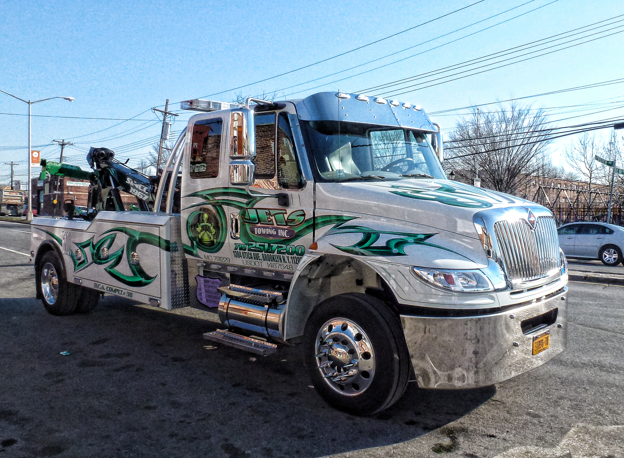 white tow truck with green detailing