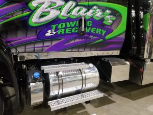 purple and green tow truck with extended cab truck panels