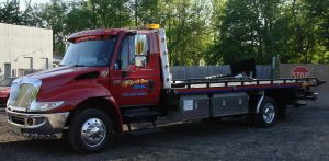 dark red flatbed tow truck