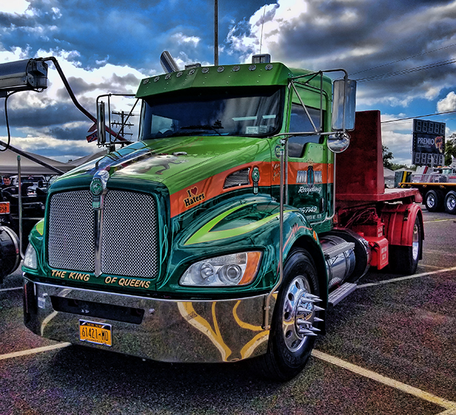 green tow truck with stainless steel accessories