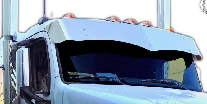 close view of sun visor on white truck cab