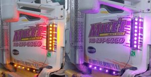 DOOR OF WHITE TRUCK SHOWING LIGHTS THAT SWITCH FROM AMBER TO PURPLE