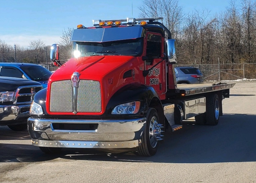 red tow truck with chrome visor and bumper