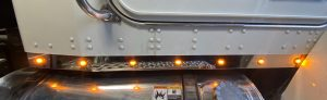 close view of cab panels with amber lights on a white truck