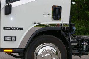 door view of white truck cab