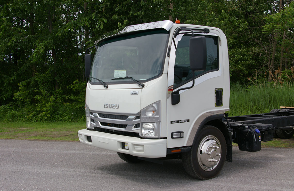 white truck cab with stainless steel visor