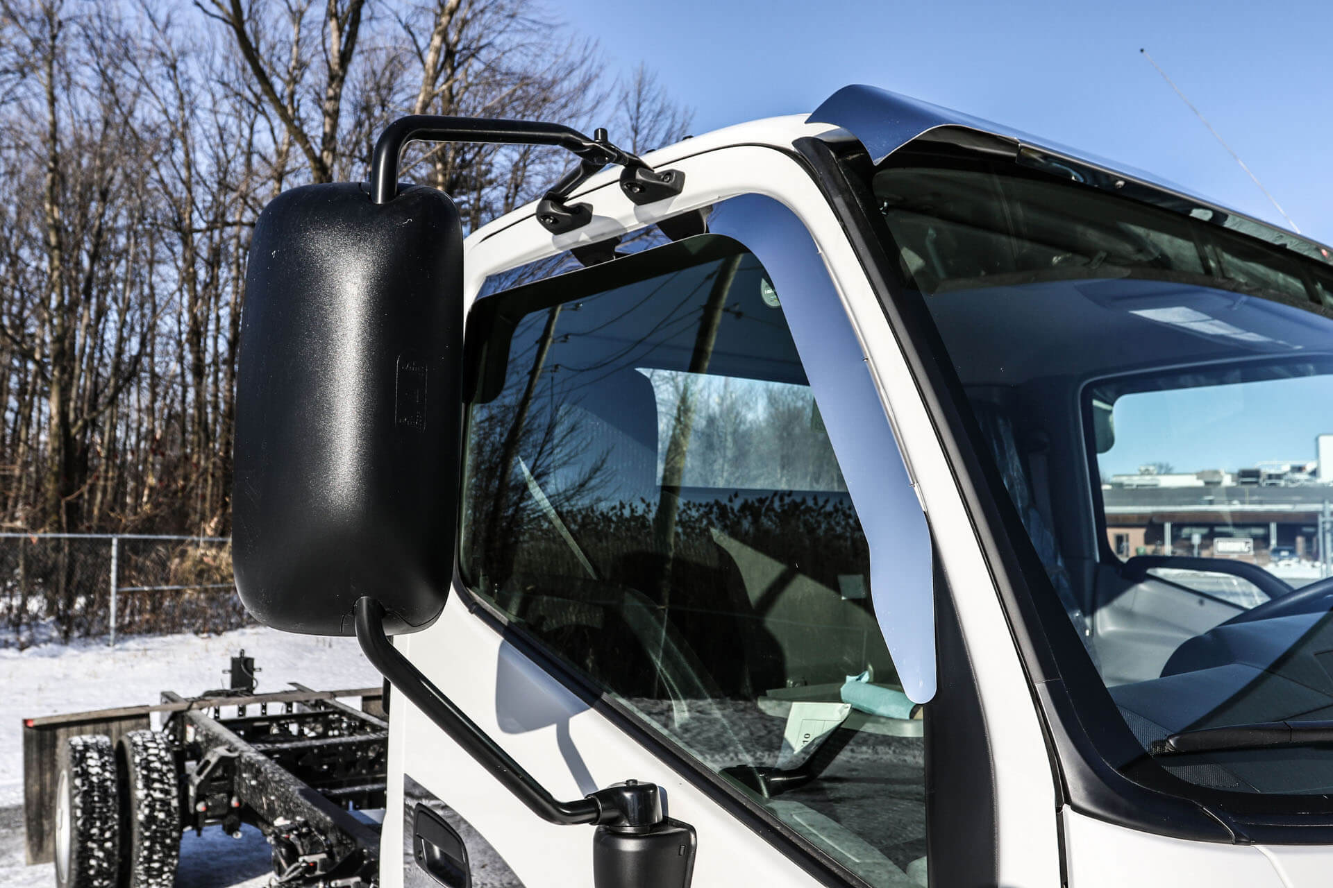 passenger side of white truck cab window and mirror