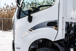 driver side of white truck cab door
