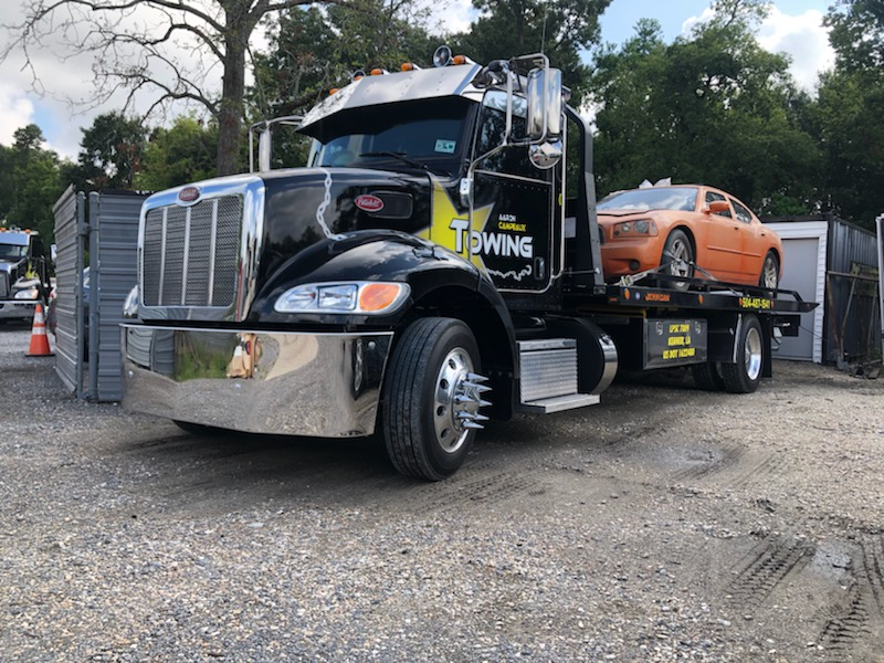 black flatbed tow truck
