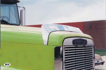 close view of green truck cab