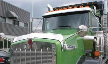 quarter profile view of green truck cab