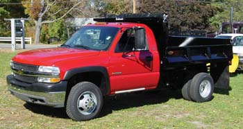 red truck cab with black flat bed