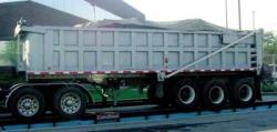 grey dump trailer with tarp system