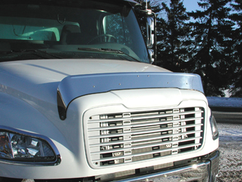 quarter profile of white truck cab