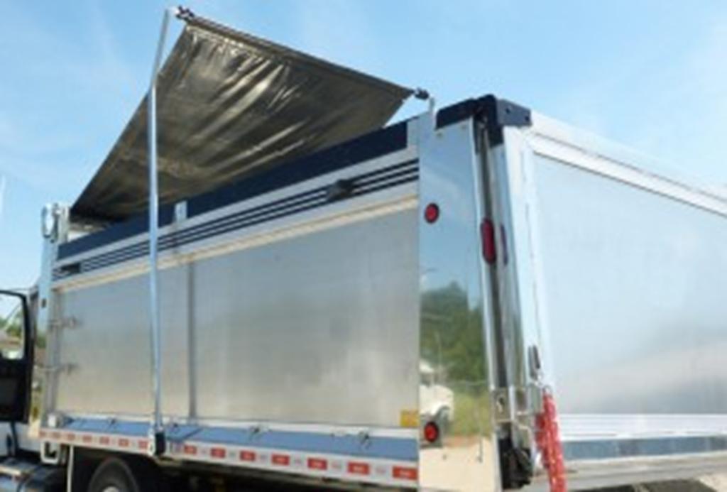 silver truck with half raised tarp