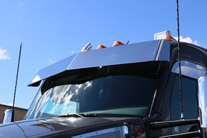 close view of black truck cab with stainless steel visor