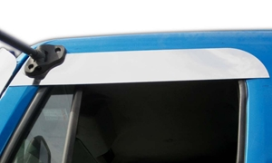 close view of truck cab window with stainless steel chops