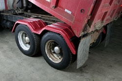 RED TANDEM FENDERS ON A RED DUMP TRUCK