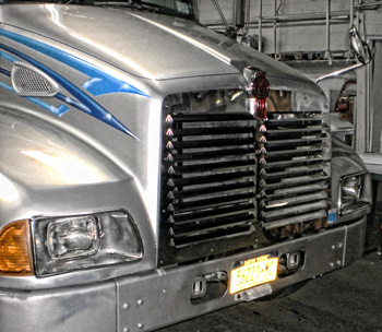 grille on silver truck cab